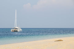 Catamaran at anchor. At the beach Stock Photos