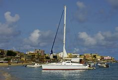 Catamaran anchored in a bay. Photo taken in west Africa stock images