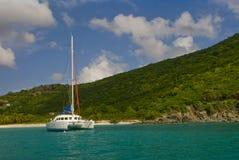 Catamaran anchored in harbor. Catamaran anchored at white harbor beach in the British Virgin Islands Stock Image