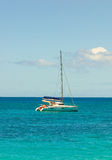 A catamaran anchored at lower bay in the grenadines Stock Photo
