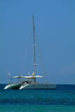 Catamaran anchored near shore. Blue sky background Royalty Free Stock Photo