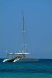 Catamaran anchored near shore Royalty Free Stock Photo