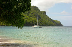 A catamaran anchored in the windward islands Stock Photo