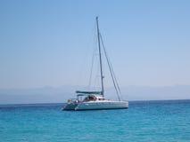 Catamaran, Anti-Paxos, Greece. Catamaran at Voutoumi Beach, Anti-Paxos, Greece Royalty Free Stock Image