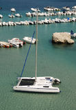 Catamaran with Background Boats Stock Photo