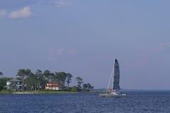 Catamaran in a bay. Catamaran going through Choktawhatchee Bay, Destin, Florida royalty free stock photo