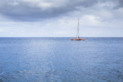 Catamaran in the bay near coast of the city Fort-de-France Stock Image