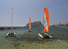 Catamaran at the Beach. Mediterranean cove with three catamaran on the water Stock Images