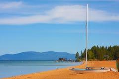Catamaran on the Beach. Beautiful lake beach with a catamaran on the sand Stock Photos