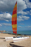Catamaran on the beach. A catamaran lies on a sandy beach Stock Photo