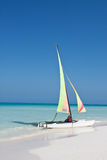Catamaran on Beach Opposite View. Catamaran resting on the beach in the Caribbean Royalty Free Stock Images