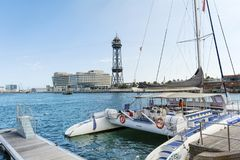 Catamaran Boat on the Port of Barcelona, Spain. BARCELONA,SPAIN-AUGUST 17 : Port of Barcelona in sunny day .Touristic boat royalty free stock photography