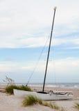 A Catamaran Boat Sitting on the Beach. Stock Photo