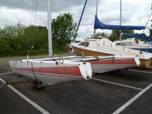 Catamaran and Boats in Dry Dock. Catamaran with other sailing craft safely waiting in dry dock Stock Photography