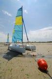 Catamaran boats and red buoy Stock Photos