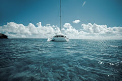 Catamaran on calm green shallow waters Royalty Free Stock Image