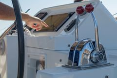 Catamaran commands with captain`s hand. Europe Stock Photo