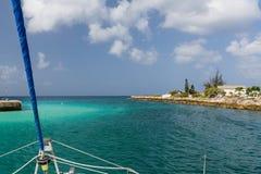 Catamaran cruising at sea in Barbados. Leaving the harbour in Barbados Stock Image