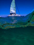 Catamaran cutting thru waves at Moreton Island Stock Photos