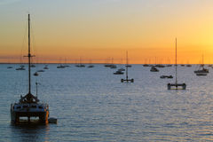 Catamaran Darwin Australia sunset. Catamarans in a bay at sunset over sea. Darwin, Australia Stock Image