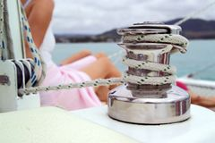Catamaran detail, with relaxing guests. Shallow focus Royalty Free Stock Photo
