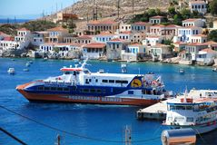 Catamaran ferry boat, Halki island Royalty Free Stock Photo