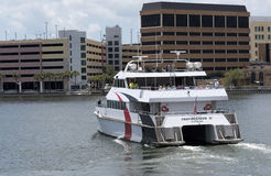 Catamaran ferry departing Tampa Florida USA. Tampa Florida USA.  A stern view of the fast passenger ferry Provincetown IV outbound to St Petersburg from downtown Stock Image