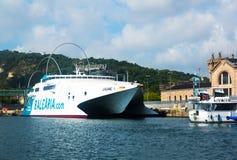 Catamaran ferry at Port Vell.  Barcelona Stock Photo
