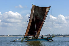 A catamaran with giant sails sit off the coast of Negombo on the west coast of Sri Lanka. Royalty Free Stock Photography