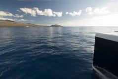 Catamaran, Haleakala Mountain in background.Maui, Hawaii Royalty Free Stock Image
