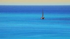 Catamaran at Hawaiian Beach Paradise. High view at the beach resort in Waikiki, Hawaii. People on catamaran, surfing, swimming and enjoying the water stock video footage