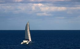Catamaran Heading out to sea royalty free stock photography