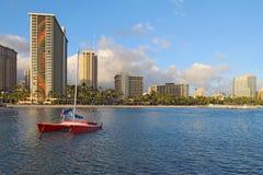Catamaran and hotels on Waikiki beach Stock Images