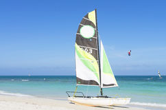 Catamaran with its colorful sails wide open Stock Images