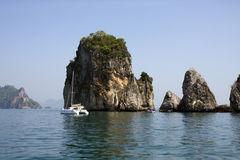 Catamaran and limestone outcrops, Krabi, Thailand Royalty Free Stock Photos