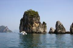 Catamaran and limestone outcrops, Krabi, Thailand Royalty Free Stock Photos