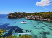 Catamaran in Macarella Bay on Minorca Royalty Free Stock Photos