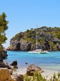 Catamaran in Macarella Bay on Minorca Royalty Free Stock Images