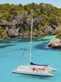 Catamaran in Macarella Bay on Minorca Stock Photo