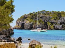 Catamaran in Macarella Bay on Minorca Stock Photos