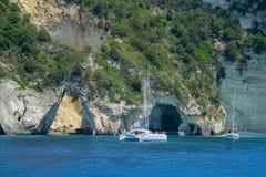 Catamaran near sea caves stock images