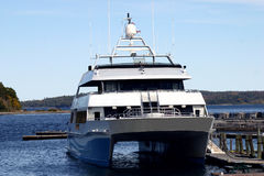 Catamaran - New England Coast. Large catamaran sits dockside waiting to board the next group of sightseers in a New England coastal town royalty free stock photography