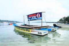 Catamaran with advertisement - Do not throw waste to see. Catamaran of organisation Cipta Karya Mustika Papua with advertisement `Do not throw waste to see` stock image
