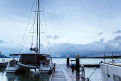 Catamaran on the pier Stock Photography