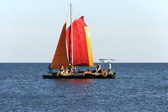 Catamaran with red sails Royalty Free Stock Images