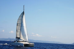 Catamaran in regatta. Photo taked during the Route of the Salt (Ruta de la sal) between Denia and Ibiza competing against sailboats for a trophy Stock Photos