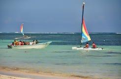 Catamaran sailboat and fishing boat Stock Photos