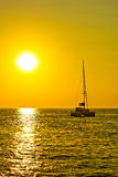 Catamaran sailboat at golden sunset Stock Photo
