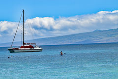 Catamaran sailboat on Kohala coast, Big Island, Hawaii. Ocean landscape with catamaran sailboat and clouds on Kohala coast, Big Island, Hawaii Royalty Free Stock Images