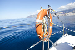 Catamaran sailboat and lifebouy Stock Photos